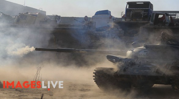 A Free Syrian Army tank firing during a heavy battle to break the siege of Aleppo