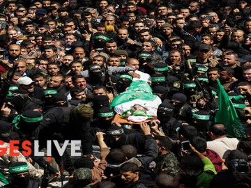 Members of the Ezzedine al-Qassam Brigades, the military wing of the Palestinian Islamist movement Hamas, carry the body of Hamas official, Mazen Faqha, during his funeral in Gaza City. Senior Hamas official Mazen Faqha, who had been freed from Israeli detention in a 2011 prisoner swap, was shot and killed by unknown gunmen in Gaza the day before his funeral. Faqha had been released after eight years in jail, along with more than 1,000 other Palestinians, in exchange for Gilad Shalit, an Israeli soldier Hamas had detained for five years