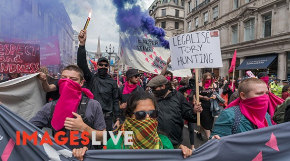 London, UK. 1st July 2017. A large march met at the BBC and marched to Parliament Square calling for Theresa May and the Conservatives to go, included an autonomous bloc who set off flares. May's snap election failed to deliver a majority and we now have a government propped up the DUP, a deeply bigoted party with links to Loyalist terrorists and bribed to support her. The election showed a rejection of her austerity austerity policies and the Grenfell Tower disaster underlined the toxic effects of Tory failure and privatisation of building regulations and inspection and a total lack of concern for the lives of ordinary people. The protesters, many of whom chanted their support of Jeremy Corbyn, say the Tories have proved themselves unfit to govern. They demand a decent health service, education system, housing, jobs and living standards for all. Peter Marshall ImagesLive