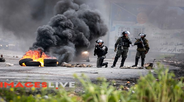 Palestinian protesters clash with Israeli security forces during a demonstration commemorating Land Day near the Israeli settlement of Beit El in the West Bank, following 'Land Day' demonstrations. 'Land Day' marks the killing of six Arab Israelis during 1976 demonstrations against Israeli confiscations of Arab land