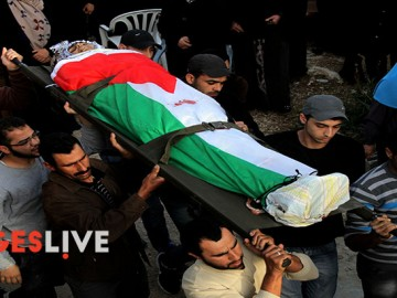 Palestinian Territory - Mourners carry the body of Palestinian Ahmad Aamer, 16, who the Israeli military said was shot dead by Israeli soldiers after he tried to stab them, during his funeral in the West Bank village of Mas'ha near Salfit March 9, 2016./Mohammed Turabi