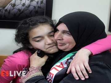 The mother (R) of Palestinian Dima al-Wawi, 12, who is believed to be the youngest female detained by Israel, greets her in the West Bank city of Tulkarem, upon her release from Israeli prison on April 24, 2016. (Mohammed Turabi).