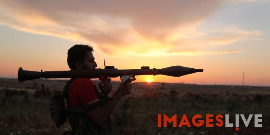 Syrian rebels firing at the Syrian Army at Menaq airport